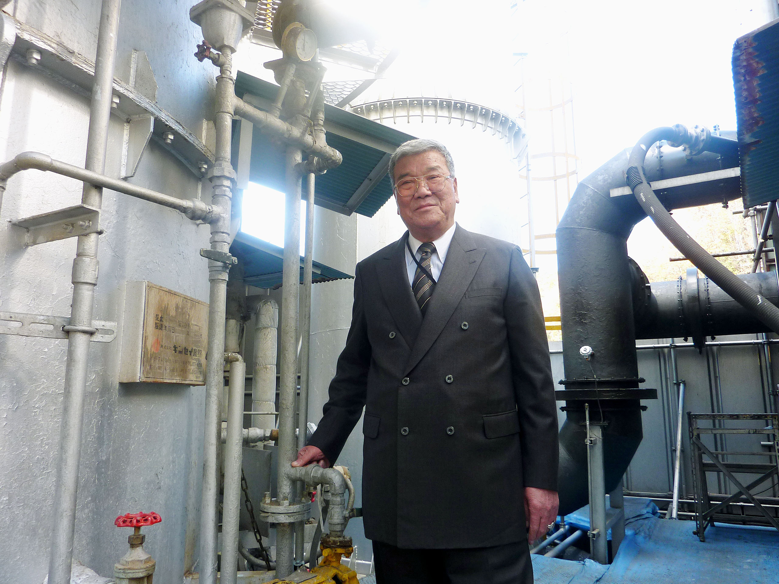 Victim: Hideaki Ikeda, president of Shouei Unso K.K., stands in front of the company's industrial waste disposal facility Dec. 3 in Hiroshima. | KYODO