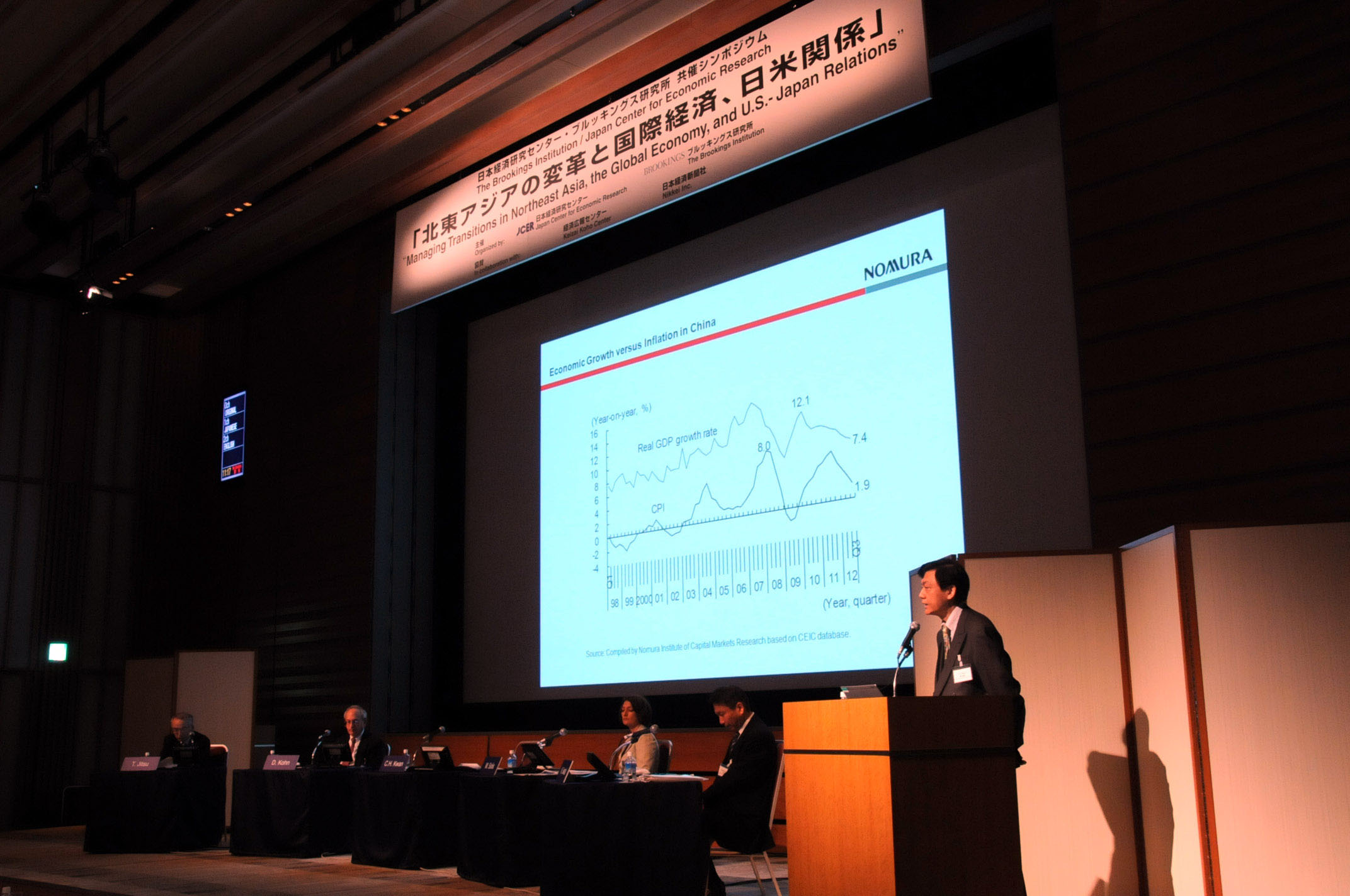 Kwan Chi Hung from the Nomura Institute of Capital Markets Research discusses the prospect of China's economic growth during a symposium held on Nov. 28 at Keidanren Kaikan in Tokyo. | SATOKO KAWASAKI