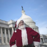 Vested interests: A man dressed as Santa listens to a speech about the 'fiscal cliff' in Washington on Dec. 12. | AFP-JIJI