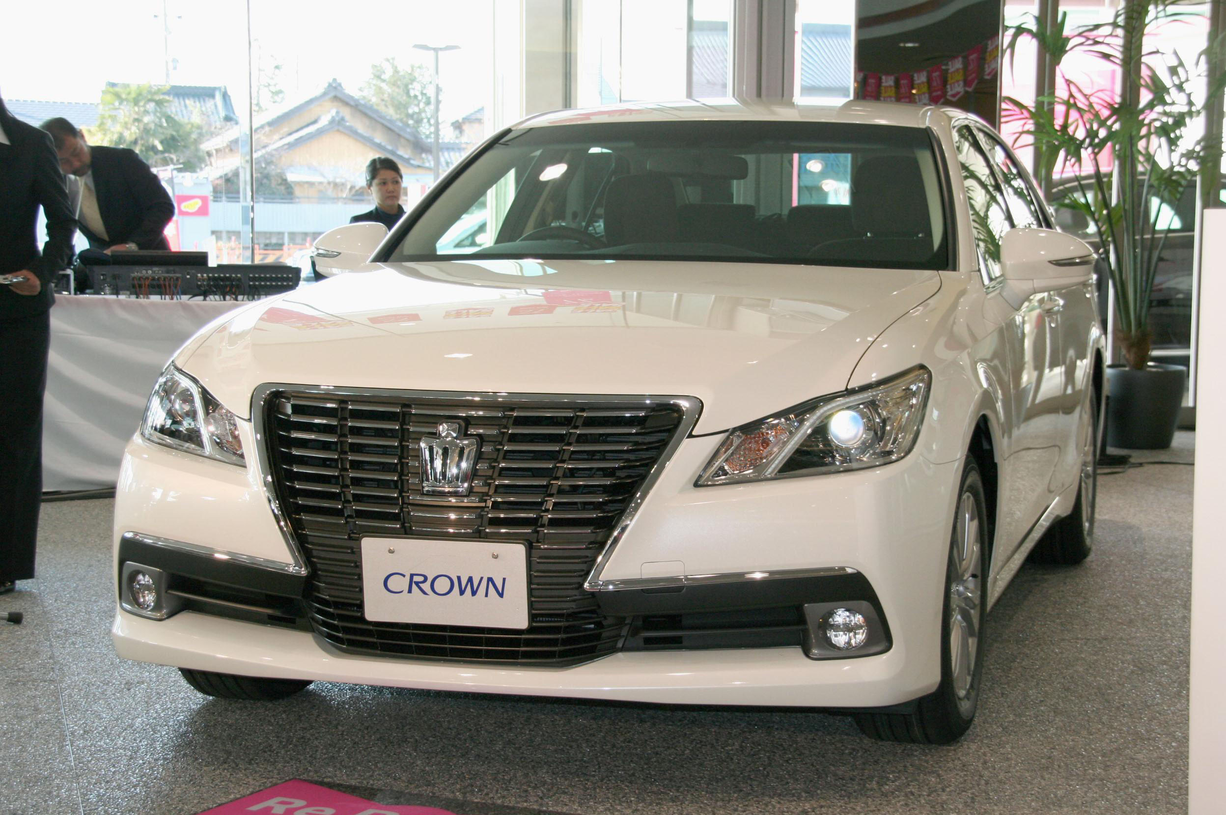 Polished jewel: Toyota Motor Corp.'s fully remodeled Crown luxury sedan is displayed at a dealership in Toyota, Aichi Prefecture, on Tuesday. | KYODO