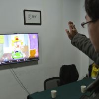 Bright ideas: A developer tests a game for children in an office in Chengdu, China. | AFP-JIJI