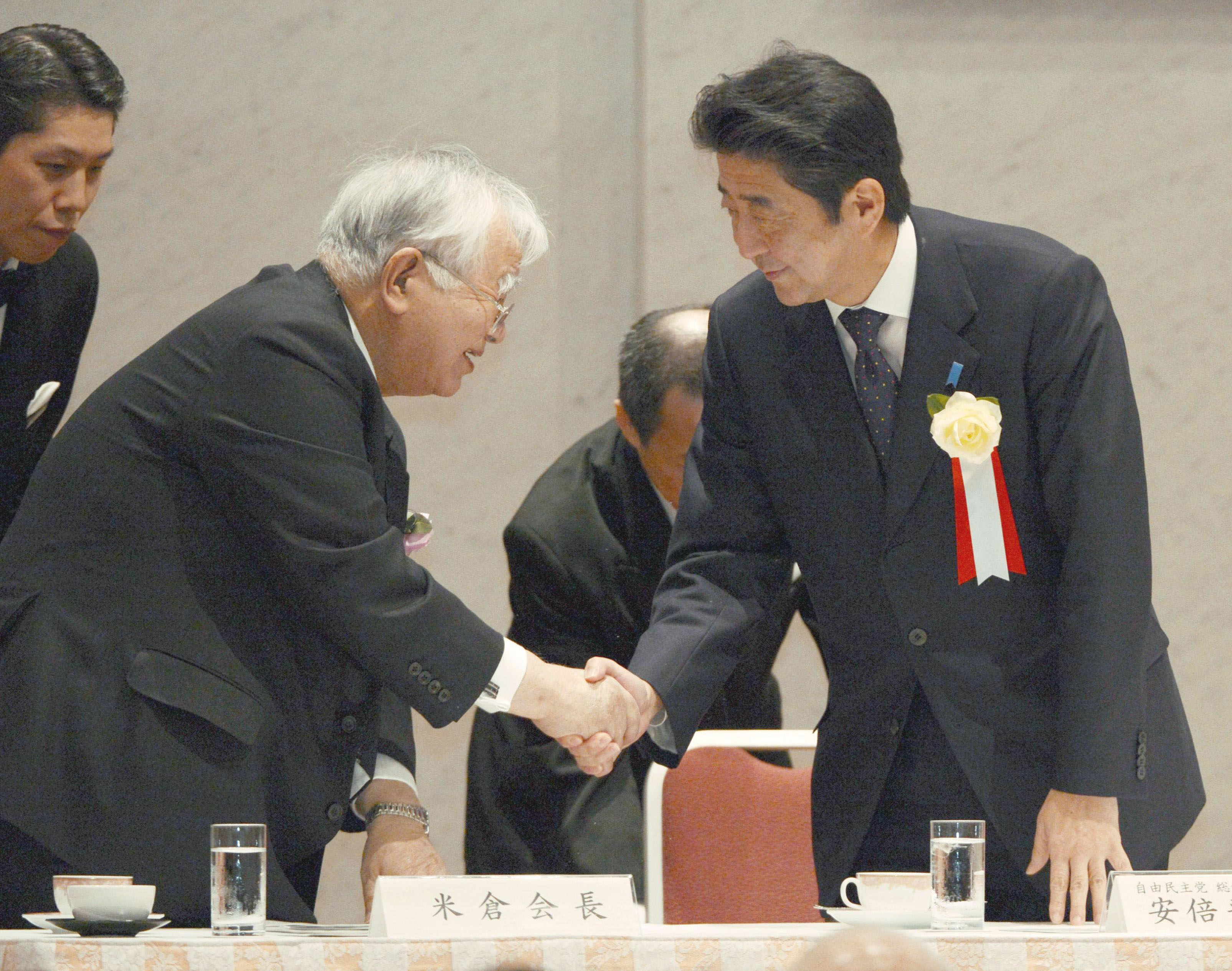 Out of the shadows: Hiromasa Yonekura (left), chairman of Keidanren, the nation's largest business lobby, greets Liberal Democratic Party President Shinzo Abe at a meeting in Tokyo on Dec. 25. | KYODO