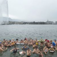 Financial bright spot: Bathers drink glasses of sparkling wine in the icy waters of Lake Geneva during the traditional New  Year's Day swim. | AP