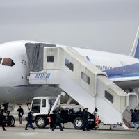Grounded: Officials inspect an All Nippon Airways Co. Dreamliner Thursday after it made an emergency landing at Takamatsu Airport in Kagawa Prefecture. | KYODO