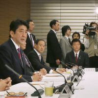 First words: Prime Minister Shinzo Abe addresses the inaugural meeting of the Council on Economic and Fiscal Policy in Tokyo on Jan. 9. | KYODO