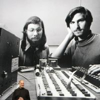 Dynamic duo: Apple CEO Steve Jobs stands in front of an old photo of himself (right) and Steve Wozniak during a January 2010 Apple event in San Francisco. | AP