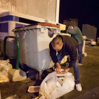 Today's special: Men search a garbage bin for food on Jan. 16 in Santa Cruz de Tenerife on the island of Tenerife. Spain's jobless rate surged to a modern-day record of 26 percent in the final quarter of 2012, data said Thursday. | AFP-JIJI