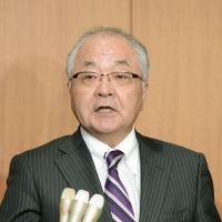 Break the cycle: Japanese Trade Union Confederation President Nobuaki Koga speaks to reporters after meeting with executives of Keidanren on Tuesday in Tokyo Tuesday. | KYODO
