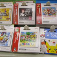 Pay and play: Download codes for digital versions of popular Nintendo games for sale at a convenience store in Osaka.