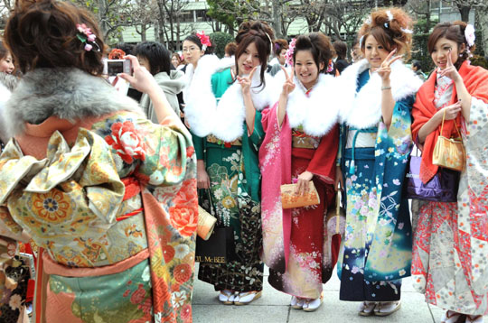 We've arrived: Young women pose for a memorial photo in January 2008 at a Coming of Age Day event in Nakano Ward, Tokyo. | SATOKO KAWASAKI PHOTO