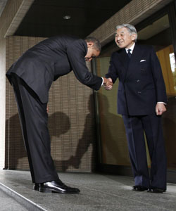 When in Tokyo: President Barack Obama shakes hands with and bows to Emperor Akihito at the same time at the Imperial Palace on Nov. 14. Some American critics accused the U.S. commander in chief of groveling to a foreign leader. | AP PHOTO
