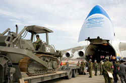 Open wide: Ground Self-Defense Force personnel load construction machinery onto a cargo jet Feb. 9 at Narita International Airport before heading to Haiti to provide reconstruction aid. | KYODO PHOTO
