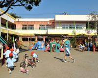 Here to play and stay: Children play at Kiyose Kindergarten. Below: A teacher says goodbye to kids in front of the kindergarten in the Tokyo suburb of Kiyose on Nov. 9. | YOSHIAKI MIURA PHOTO