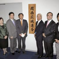Kansai club: Seven prefectural governors in the Kansai region attend the launching ceremony for their Kansai Regional League in Kita Ward, Osaka, on Dec. 4. | KYODO PHOTO