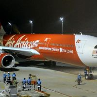 Flight of fancy: The first flight of Malaysian low-cost carrier AirAsia X arrives at Tokyo's Haneda airport from Kuala Lumpur on Dec. 9. | KYODO PHOTO