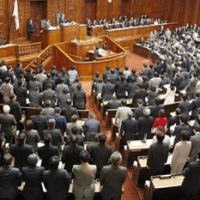 Job well done: Lawmakers stand as the fiscal 2010 supplementary budget clears the Lower House in November. | KYODO PHOTO