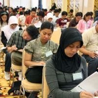 Prepping up: Indonesian nurses take an examination in Jakarta in March 2009 prior to coming to Japan in search of work. | KYODO PHOTO