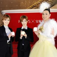 Crossover appeal: Takarazuka actresses (from left) Fuuto Nozomi and Rio Asumi along with male cross-dresser Mitz Mangrove promote Unilever Japan cosmetic cream in Tokyo on Oct. 18. | KYODO PHOTO