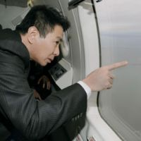 Look but don't touch: Foreign Minister Seiji Maehara views the disputed island of Kunashiri off Hokkaido aboard a Japan Coast Guard plane in December. | KYODO PHOTO