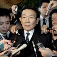 Point man: Kaoru Yosano, fiscal and economic policy minister, fields questions from reporters Wednesday after the first meeting of Cabinet members to discuss welfare and tax issues at the Prime Minister's Office. | KYODO PHOTO