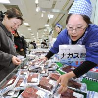 Meat market: Vendors pitch whale meat during the Hanshin no Kujira Matsuri food fair Thursday at the Hanshin department store in Kita Ward, Osaka. | KYODO PHOTO