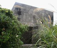 Hole in the wall: Murder suspect Tatsuya Ichihashi is believed to have hidden in this concrete structure photographed Monday on Ohajima, a tiny island off Kumejima in Okinawa. | KYODO PHOTO