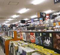 All that jazz: A shopper browses through the offerings at diskunion JazzTokyo in the Ochanomizu district. The LP and CD store bills itself as one of the world's largest devoted to the genre. | KYODO PHOTO