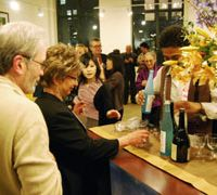Tipple tourism: New Yorkers try out sake from Kanazawa at a promotional event on Feb. 1 in Manhattan to drum up tourism to the Ishikawa Prefecture capital. | KYODO PHOTO