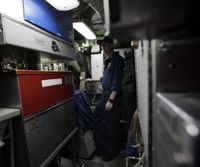 Smoke-free zone: Petty Officer Luke Riblet stands in the former smoking area in the engine room of the attack sub USS Charlotte at the Yokosuka naval base in Kanagawa Prefecture last week. | AP PHOTO