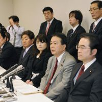 The loyal opposition: Koichiro Watanabe (front row, second from right), a Democratic Party of Japan member close to Ichiro Ozawa, faces the media Thursday along with other DPJ Lower House lawmakers to announce their wish to leave the party's parliamentary group in the Diet. | KYODO PHOTO