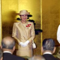 The Crown Princess is flanked by Princess Kiko (left) and Empress Michiko during the awards ceremony for the 39th Florence Nightingale Medals at the Japanese Red Cross Society's headquarters in Tokyo in June 2003. | AP PHOTOS