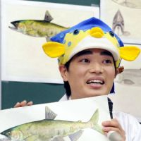 If the cap fits: Fish expert and TV celebrity Sakana-kun speaks during a December news conference in Tokyo. | KYODO PHOTO