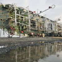 Destruction from the sea: A wrecked fishing boat lies in Hachinohe, Aomori Prefecture, on Sunday. | KYODO PHOTO