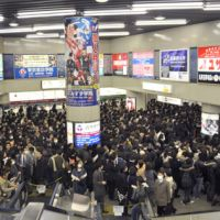 Less is more: Passengers crowd the ticket gate Monday morning at JR Kichijoji Station on the Chuo Line, where services were reduced due to expected power outages. | KYODO PHOTO