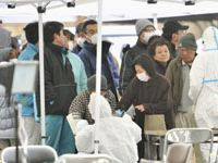 Hot or not: People are checked for radiation exposure in Koriyama, Fukushima Prefecture, on Tuesday. | KYODO PHOTO