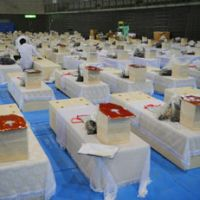 Temporary morgue: Coffins containing victims of the March 11 killer tsunami fill a gymnasium in Rifu, Miyagi Prefecture, on Friday. | KYODO PHOTO