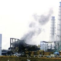 Where's the fire?: Gray smoke emerges from the No. 3 reactor at the Fukushima No. 1 power plant at 4:10 p.m. Monday, in this picture taken by Tokyo Electric Power Co. The Nuclear and Industrial Safety Agency said no change was observed in radiation levels at the compound, and that the temperature and pressure inside the reactor also remained unchanged. | KYODO PHOTO