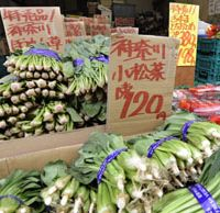 Safe, so far: Spinach and other leaf vegetables are displayed Wednesday in Shinagawa Ward, Tokyo, together with signs that they are from Kanagawa Prefecture. | KYODO PHOTO