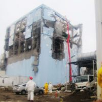 Pump it up: Water-spraying operations to cool down a spent nuclear-fuel pool at the Fukushima No. 1 power plant's No. 4 reactor continue Tuesday with trucks using a concrete squeeze pump and a 50-meter arm for pouring water from a higher point. | KYODO PHOTO