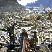 Teamwork: Ground Self-Defense Force personnel search for people in Onagawa, Miyagi Prefecture, on Friday. | KYODO PHOTO