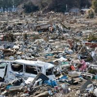 Calamity, humanity: The March 11 tsunami aftermath in Nobiru, Miyagi Prefecture, is shown on March 25. | ROBERT GILHOOLY PHOTO