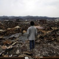 Quake response: A man looks over the devastation in Kesennuma, Miyagi Prefecture, on Wednesday. | AP PHOTO