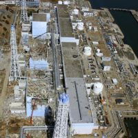 Safe distance: The crippled Fukushima No. 1 nuclear power plant is shown in this photo taken by an unmanned aircraft on March 24.   KYODO PHOTO/AIR PHOTO SERVICE