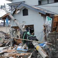 Unlivable: Houses destroyed by the March 11 tsunami are seen in Shichigahama, Miyagi Prefecture, on March 31. | SATOKO KAWASAKI PHOTO