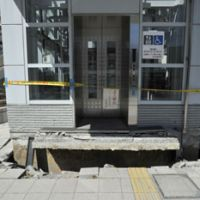 Liftoff: Liquefaction caused by the March 11 quake has partially lifted an elevator out of the ground near Shin Urayasu Station in Chiba Prefecture. | YOSHIAKI MIURA PHOTO