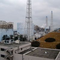 Costly cleanup: Smoke billows from reactor No. 3 at the Fukushima No. 1 nuclear plant in Okuma, Fukushima Prefecture, on March 15. Decommissioning damaged reactors 1, 2, 3 and 4 (left to right) will be time-consuming and costly work. | AP / TOKYO ELECTRIC POWER CO.