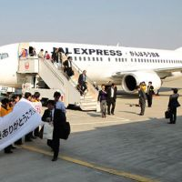 Wecome back: A JAL Express jetliner from Tokyo arrives at Sendai Airport in Natori, Miyagi Prefecture, on Wednesday. | KYODO
