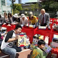 Early Christmas: Chihiro Tada, president of the Tokyo Toy Museum in Shinjuku Ward, joins some of the 100 volunteers who helped pack a collection of free toys in the Yotsuya district to give to children in disaster-hit areas of eastern Japan. | YOSHIAKI MIURA