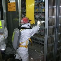 Pressure job: A worker in protective gear checks a water-level indicator at the Fukushima No. 1 nuclear power plant¥x81fs reactor No. 1 on Tuesday. | TEPCO / KYODO