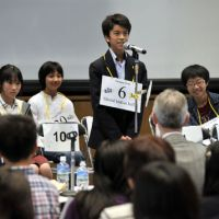 Yuichi Yoshioka, 12, recites the spelling of an English word Saturday at The Japan Times Spelling Bee in the newspaper's head office in Minato Ward, Tokyo. Yoshioka's victory won him a seat at the National Spelling Bee in Washington. | YOSHIAKI MIURA PHOTOS